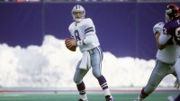 Quarterback Troy Aikam #8 of the Dallas Cowboys drops back to pass against the New York Giants during an NFL football game January 2, 1994 at Giants Stadium in East Rutherford, New Jersey. Aikman played for the Cowboys from 1989-00. (Photo by Focus on Sport/Getty Images)