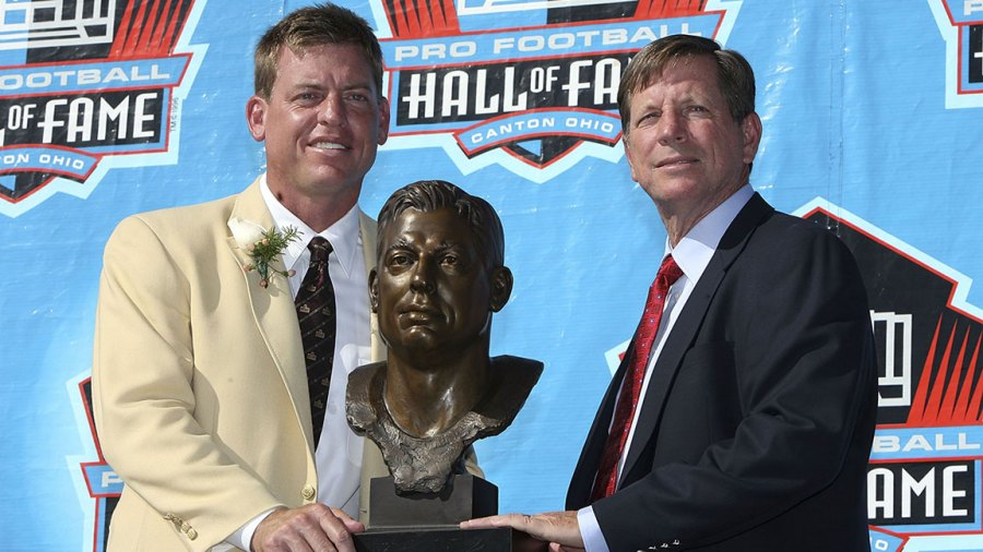 Troy Aikman of the Dallas Cowboys poses with his bust and his presenter Norv Turner after Aikman's induction during the Class of 2006 Pro Football Hall of Fame Enshrinement Ceremony at Fawcett Stadium on August 5, 2006 in Canton, Ohio. (Photo by Doug Benc/Getty Images)