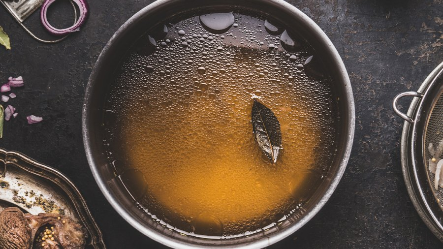 Clear broth or stock without meat in cooking pot