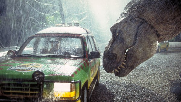A Tyrannosaurus Rex menaces the theme park's first customers in a scene from the film 'Jurassic Park', 1993. (Photo by Murray Close/Getty Images)