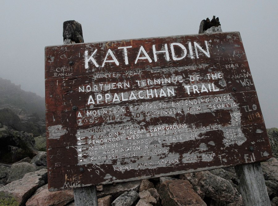 A weathered sign at Baxter Peak marks the elevation of Katahdin