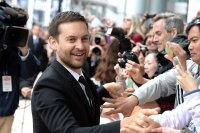 Actor/producer Tobey Maguire greets fans as he attends the 'Pawn Sacrifice' premiere during the 2014 Toronto International Film Festival at Roy Thomson Hall on September 11, 2014 in Toronto, Canada. (Photo by George Pimentel/Getty Images)