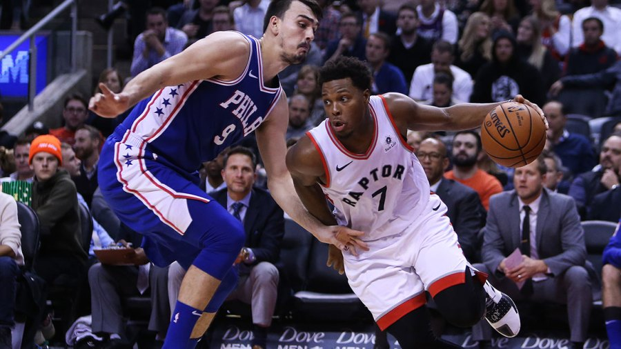 Kyle Lowry #7 of the Toronto Raptors dribbles the ball as Dario Saric #9 of the Philadelphia 76ers defends during the second half of an NBA game at Scotiabank Arena on October 30, 2018 in Toronto, Canada. NOTE TO USER: User expressly acknowledges and agrees that, by downloading and or using this photograph, User is consenting to the terms and conditions of the Getty Images License Agreement. (Photo by Vaughn Ridley/Getty Images)