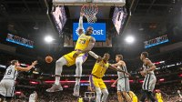 LeBron James #23 of the Los Angeles Lakers hangs onto the rim after a turnover at AT&T Center on October 27 , 2018 in San Antonio, Texas. NOTE TO USER: User expressly acknowledges and agrees that , by downloading and or using this photograph, User is consenting to the terms and conditions of the Getty Images License Agreement. (Photo by Ronald Cortes/Getty Images)