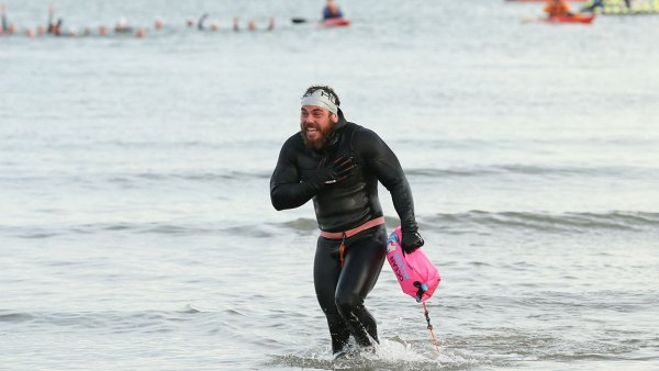 Ross Edgley of England celebrates finishing his 'Great British Swim', an historic 2,000 mile swim around Great Britain on November 4, 2018 in Margate, England. (Photo by Luke Walker/Getty Images for Red Bull)