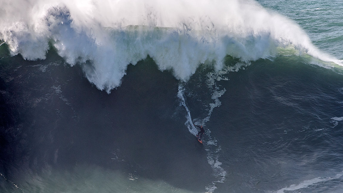 Watch This Fearless Surfer Take on a Gigantic 60-Foot Wave in Nazaré