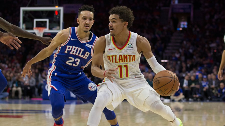 Trae Young #11 of the Atlanta Hawks dribbles the ball against Landry Shamet #23 of the Philadelphia 76ers at the Wells Fargo Center on October 29, 2018 in Philadelphia, Pennsylvania. NOTE TO USER: User expressly acknowledges and agrees that, by downloading and or using this photograph, User is consenting to the terms and conditions of the Getty Images License Agreement. (Photo by Mitchell Leff/Getty Images)