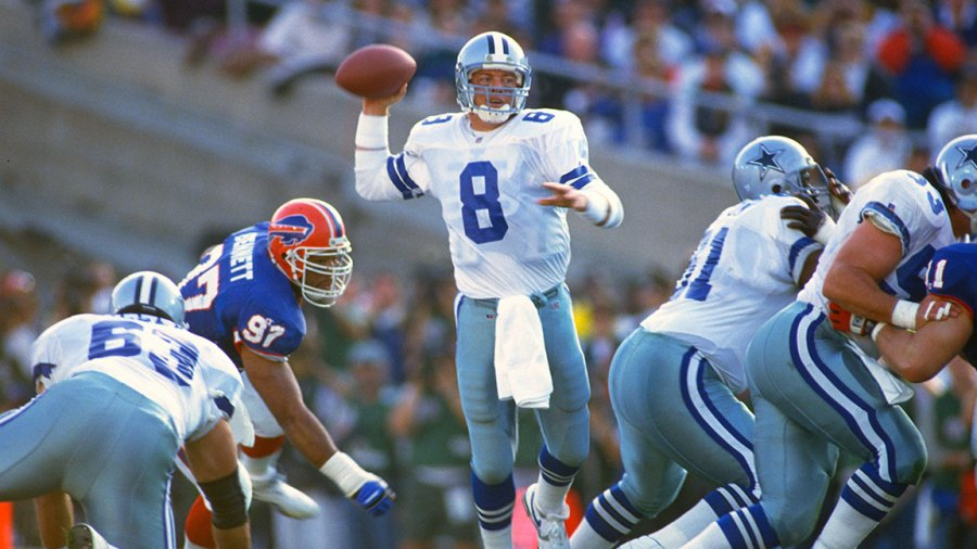 Troy Aikman #8 of the Dallas Cowboys drops back to pass against the Buffalo Bills during Super Bowl XXVII on January 31, 1993 at The Rose Bowl in Pasadena, California. The Cowboys won the Super Bowl 52-17. (Photo by Focus on Sport/Getty Images)