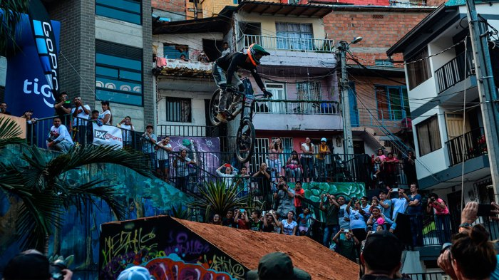 Mexican extreme mountain bike athlete Nicolas Cantu makes a jump during the Downhill Challenge Medellin 2018 in the Comuna 13 neighbouhood in Medellin, Colombia, on December 2, 2018. - The competition in Medellin set a new Guinness World Record for the longest track of Downhill Urbano. (Photo by Camilo GIL / AFP) (Photo credit should read CAMILO GIL/AFP/Getty Images)