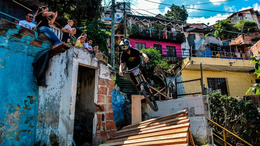 US extreme mountain bike athlete Ray Syron takes part in the Downhill Challenge Medellin 2018 in the Comuna 13 neighbouhood in Medellin, Colombia, on December 2, 2018. - The competition in Medellin set a new Guinness World Record for the longest track of Downhill Urbano. (Photo by Camilo GIL / AFP) (Photo credit should read CAMILO GIL/AFP/Getty Images)