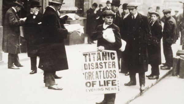 Newspaper boy Ned Parfett sells copies of the Evening News telling of the Titanic maritime disaster