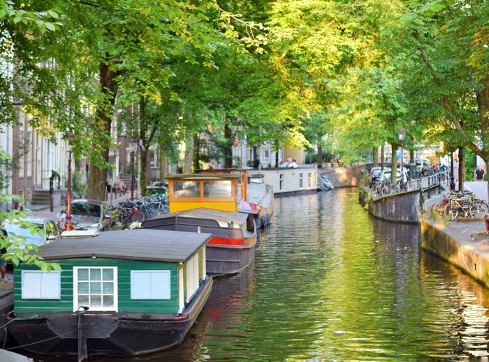 Boats Moored In Water, Amsterdam