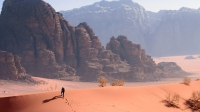 A Hiker on a ridge in the desert in Wadi Rum, Jordan