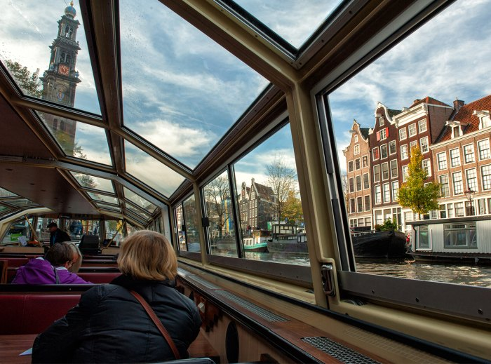 Amsterdam view from the interior of a canal cruise boat.
