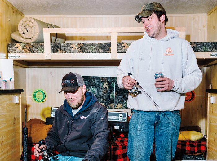 Anglers in a heated ice-fishing shack.