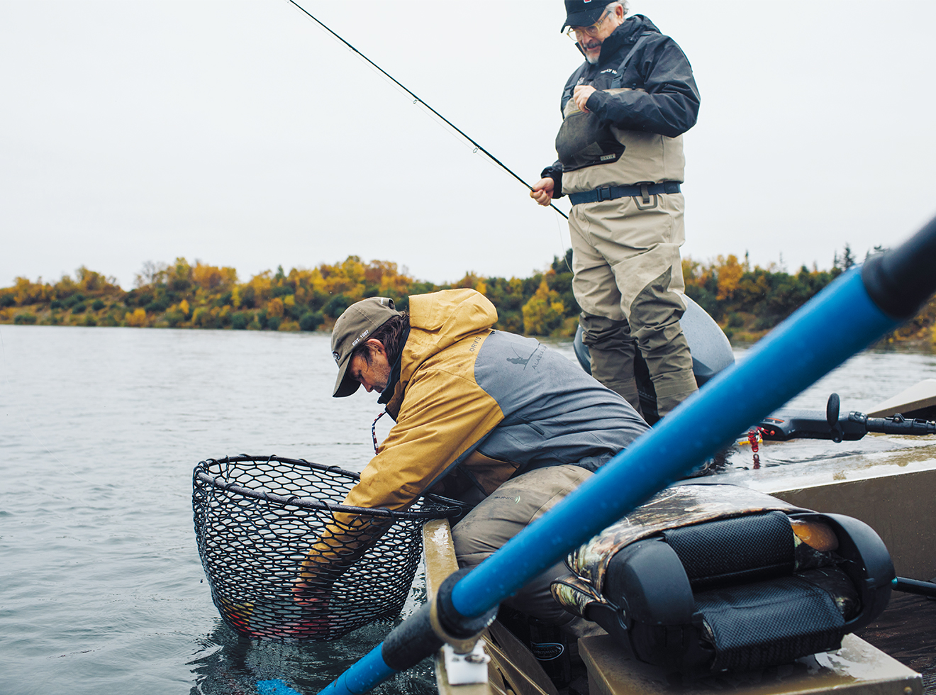 Kraft helps Collier unhook a sockeye salmon during a day pf fishing on the Kvichak River, a waterway downstream from the proposed Pebble Mine.