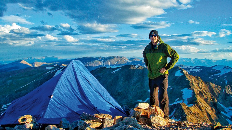 Kedrowski setting up camp for the night on Mount Lincoln in 2011.