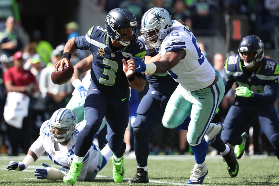 Russell Wilson #3 of the Seattle Seahawks scrambles in the first quarter against the Dallas Cowboys during their game at CenturyLink Field on September 23, 2018 in Seattle, Washington. (Photo by Abbie Parr/Getty Images)