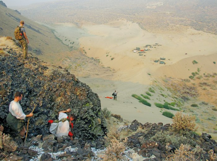 SERE trainees look down at their improvised camp during six days surviving in the desert.