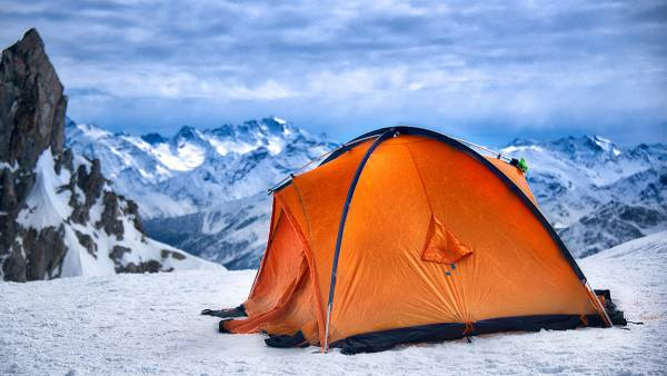 Tent On Snow Covered Mountain Against Sky