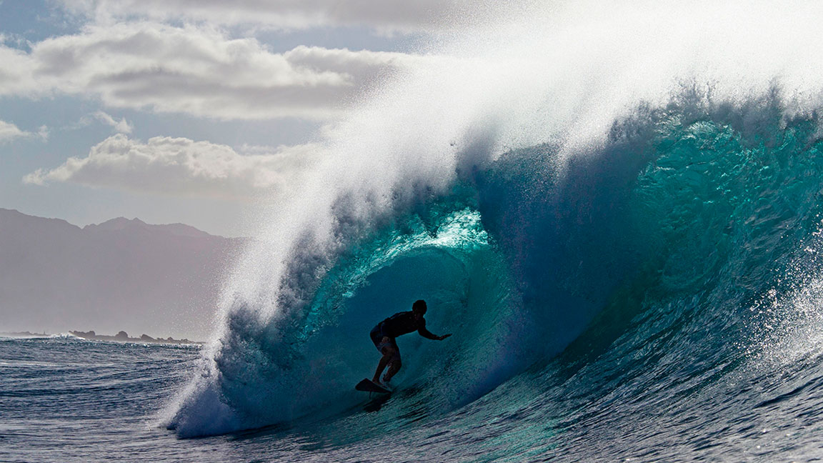 Snowboarders Survive an Avalanche, a Surfer Rides With Dolphins, and the Best Adventure Videos of the Week