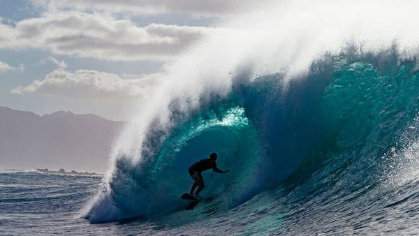 A surfer rides a wave while practicing for Da Hui Backdoor shootout at the Pipeline Masters on Oahu's North Shore, Hawaii on January 2, 2019. - The Da Hui Backdoor shootout starts on January 4, 2019. (Photo by brian bielmann / Brian Bielman Photography / AFP) / RESTRICTED TO EDITORIAL USE (Photo credit should read BRIAN BIELMANN/AFP/Getty Images)