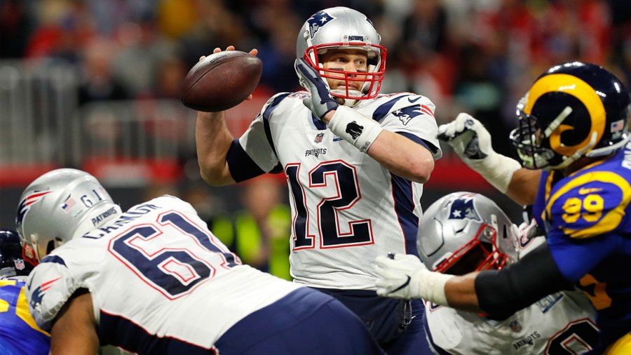 Tom Brady #12 of the New England Patriots thorws a pass against the Los Angeles Rams in the second quarter during Super Bowl LIII against the Los Angeles Rams at Mercedes-Benz Stadium on February 3, 2019 in Atlanta, Georgia. (Photo by Kevin C. Cox/Getty Images)