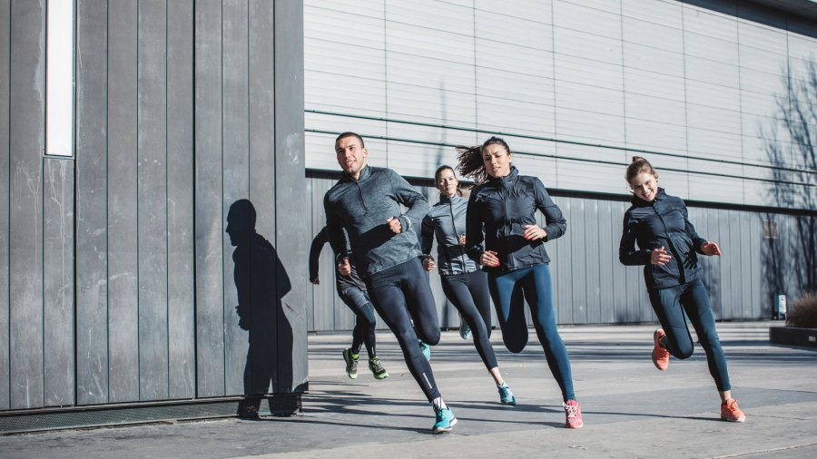 Young men and women running on city streets