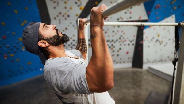 Man doing pullups in climbing gym