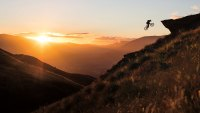 Carson Storch jumping Coronet Peak in New Zealand on mountain bike