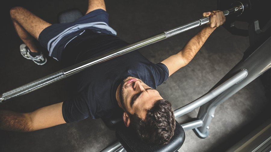 Young man doing bench press exercise