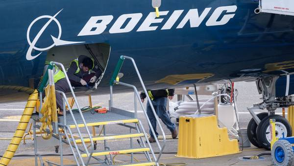 Employees work in the cargo hold of a Boeing 727 MAX 9 test plane outside the company's factory, on March 14, 2019 in Renton, Washington. The 737 MAX, Boeing's newest model, has been been grounded by aviation authorities throughout the world after the crash of an Ethiopian Airlines 737 MAX 8 on March 10. (Photo by Stephen Brashear/Getty Images)