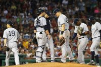 BOSTON, MA - AUGUST 05: Masahiro Tanaka #19 heads to the dugout after being taken out of the game by Manager Aaron Boone of the New York Yankees in the fifth inning of a game against the Boston Red Sox at Fenway Park on August 5, 2018 in Boston, Massachusetts. (Photo by Adam Glanzman/Getty Images)