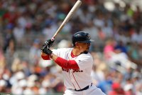 FORT MYERS, FLORIDA - MARCH 09: Mookie Betts #50 of the Boston Red Sox at bat against the New York Mets during the Grapefruit League spring training game at JetBlue Park at Fenway South on March 09, 2019 in Fort Myers, Florida. (Photo by Michael Reaves/Getty Images)