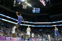 Zion Williamson #1 of the Duke Blue Devils dunks the ball against the North Carolina Tar Heels during their game in the semifinals of the 2019 Men's ACC Basketball Tournament at Spectrum Center on March 15, 2019 in Charlotte, North Carolina. (Photo by Streeter Lecka/Getty Images)