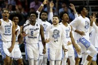 CHARLOTTE, NORTH CAROLINA - MARCH 14: The North Carolina Tar Heels bench reacts to a three pointer against the Louisville Cardinals during their game in the quarterfinal round of the 2019 Men's ACC Basketball Tournament at Spectrum Center on March 14, 2019 in Charlotte, North Carolina. (Photo by Streeter Lecka/Getty Images)