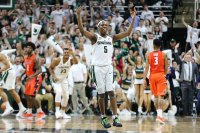 EAST LANSING, MI - FEBRUARY 20: Cassius Winston #5 of the Michigan State Spartans celebrates after a play late in the second half during a game against the Illinois Fighting Illini at Breslin Center on February 20, 2018 in East Lansing, Michigan. (Photo by Rey Del Rio/Getty Images)