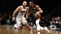 Spencer Dinwiddie #8 of the Brooklyn Nets drives against Evan Fournier #10 of the Orlando Magic during their game at the Barclays Center on January 23, 2019 in New York City. Al Bello/Getty Images