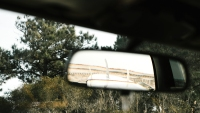 photo of a surfboard in the rearview mirror