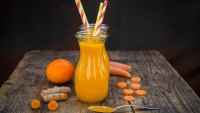 Juice made with turmeric, carrots, and orange