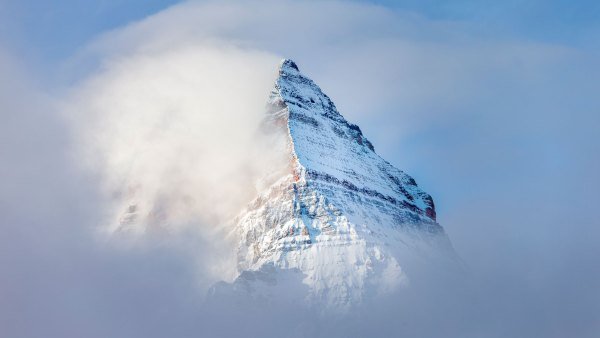 Mountain peak in fog