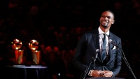 Former Miami Heat player Chris Bosh reacts during his jersey retirement ceremony at halftime of the game between the Miami Heat and the Orlando Magic at American Airlines Arena on March 26, 2019 in Miami, Florida