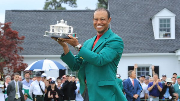AUGUSTA, GEORGIA - APRIL 14: Tiger Woods of the United States celebrates with the Masters Trophy during the Green Jacket Ceremony after winning the Masters at Augusta National Golf Club on April 14, 2019 in Augusta, Georgia. (Photo by David Cannon/Getty Images)