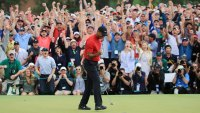 AUGUSTA, GEORGIA - APRIL 14: Tiger Woods of the United States celebrates after sinking his putt on the 18th green to win during the final round of the Masters at Augusta National Golf Club on April 14, 2019 in Augusta, Georgia. (Photo by David Cannon/Getty Images)