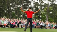 AUGUSTA, GEORGIA - APRIL 14: (Sequence frame 5 of 12) Tiger Woods of the United States celebrates after making his putt on the 18th green to win the Masters at Augusta National Golf Club on April 14, 2019 in Augusta, Georgia. (Photo by Kevin C. Cox/Getty Images)