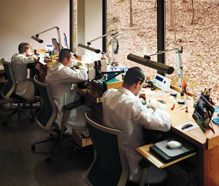 technicians and watchmakers in the company's workshop