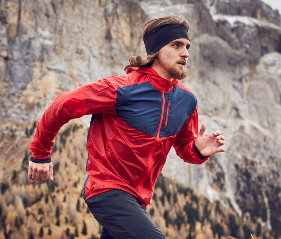 Man running at high altitude in the mountains