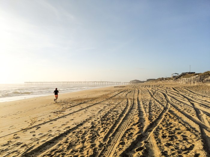 photo of a runner on the beach in Nags Head