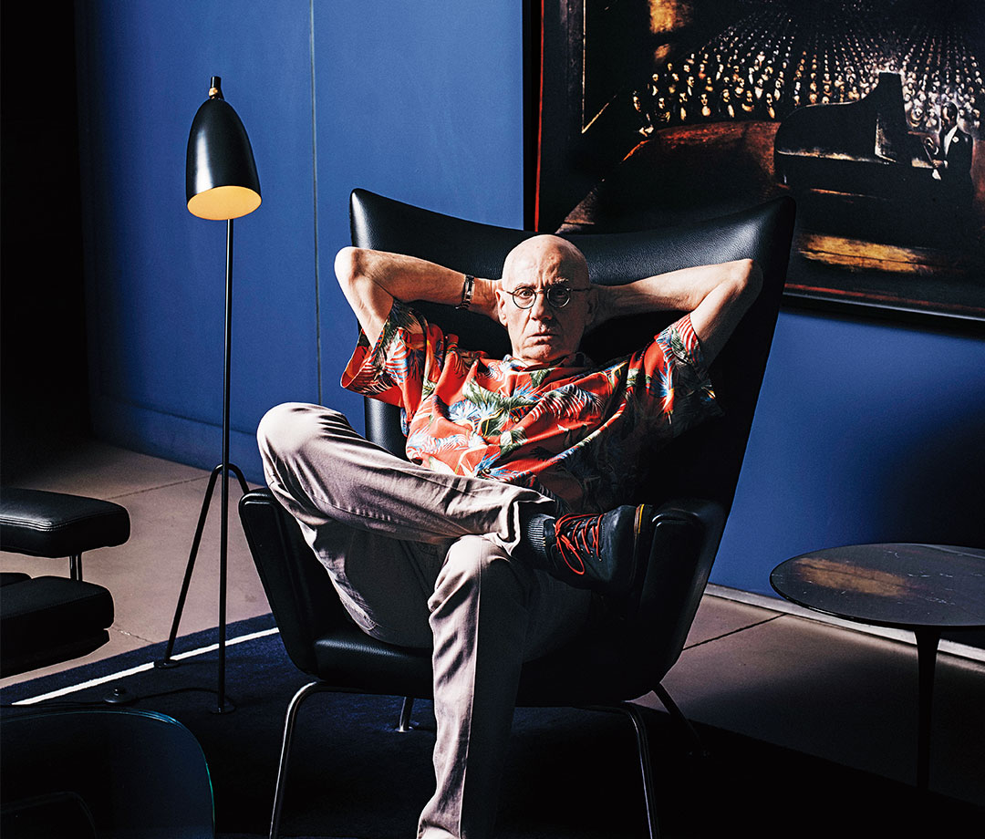 James Ellroy lounging at home, in chair