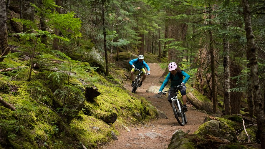 Couple riding mountain bikes